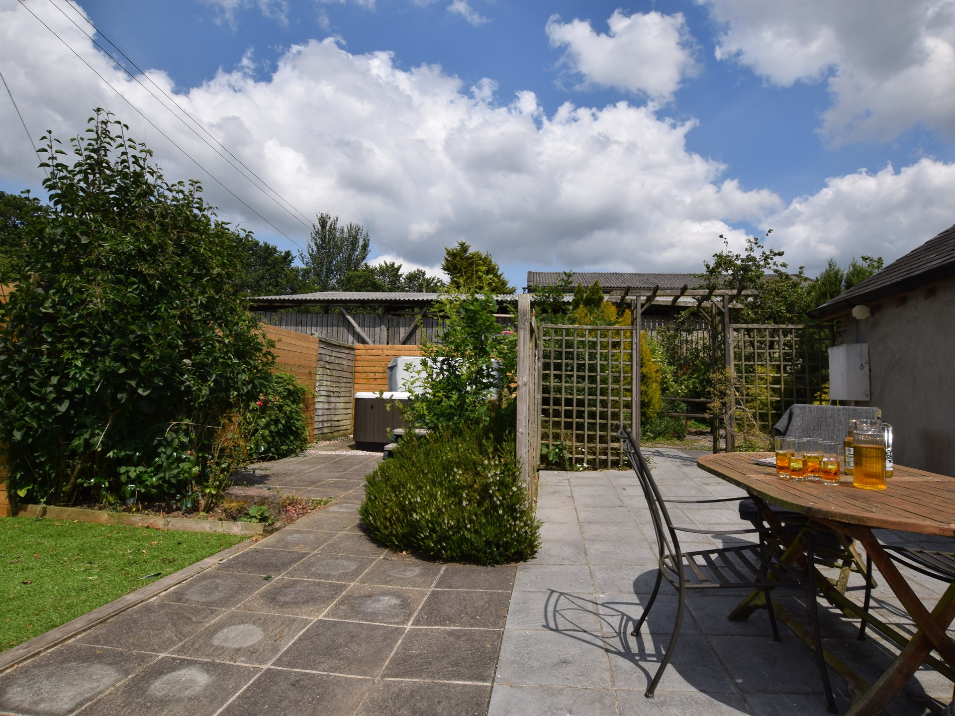 Enjoy the private garden and hot tub area