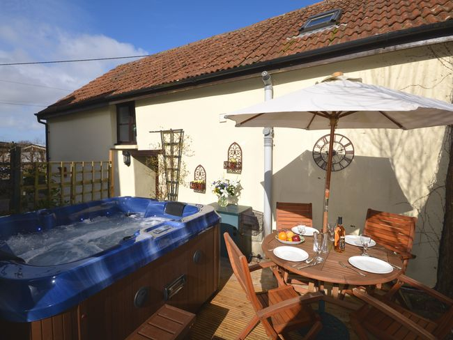 Enjoy the decked area with hot tub and seating area