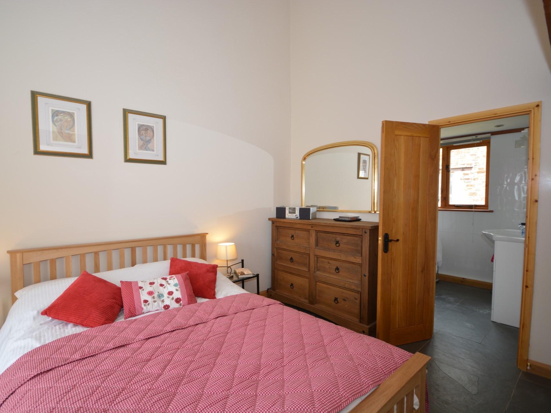 King-size bedroom leading to en-suite shower room