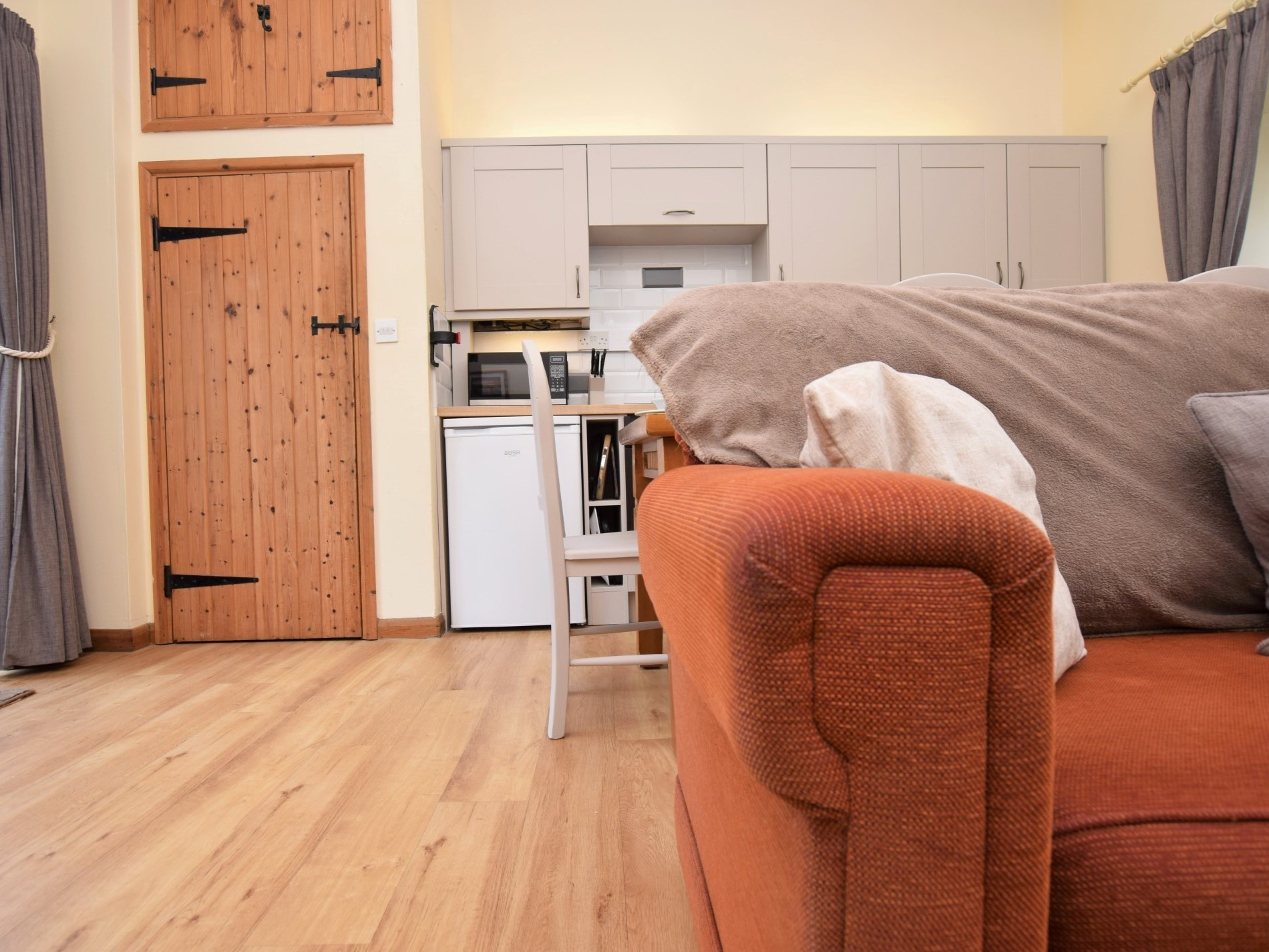 Step down from dinner into the lounge area with wood burner