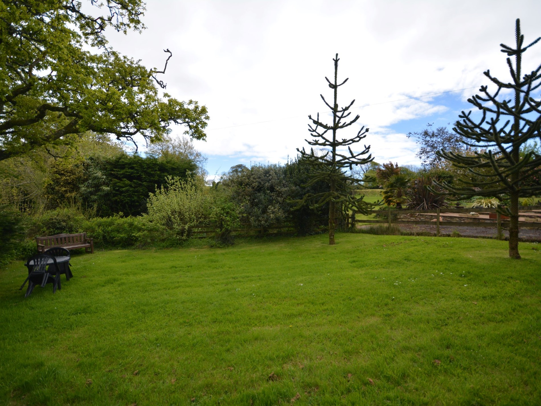 Large enclosed garden with countryside views