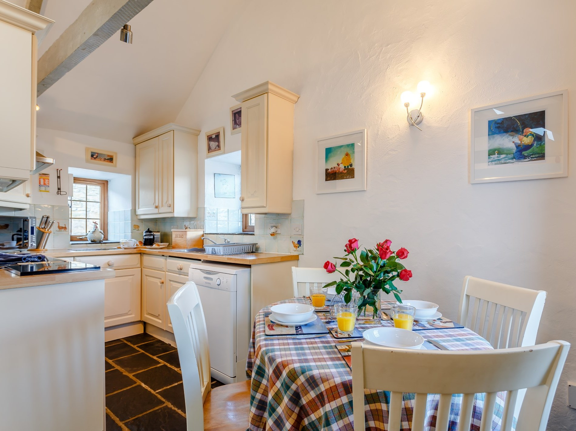 Bright and open kitchen/dining arrangement