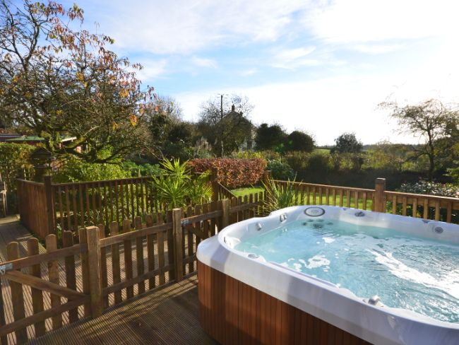 View of the hot tub and countryside views beyond