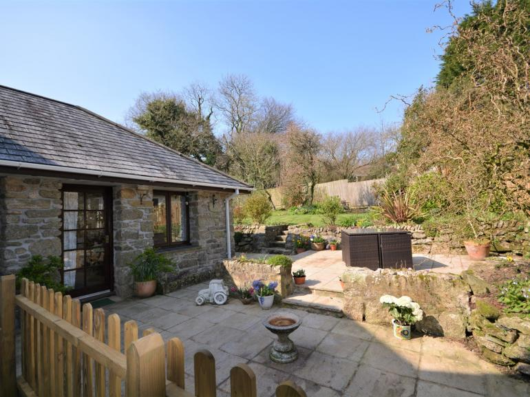 View towards the cottage and enclosed garden with seating
