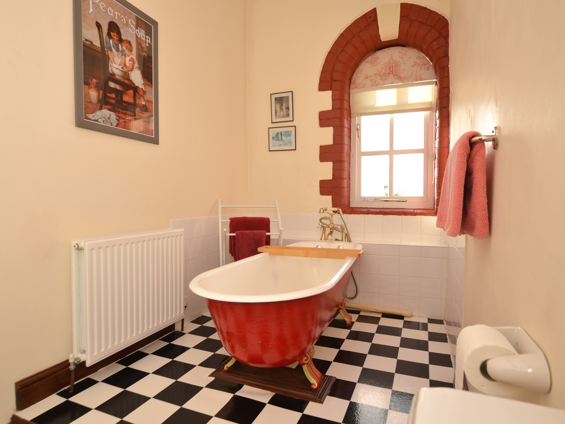 Bathroom with luxurious roll-top bath and WC