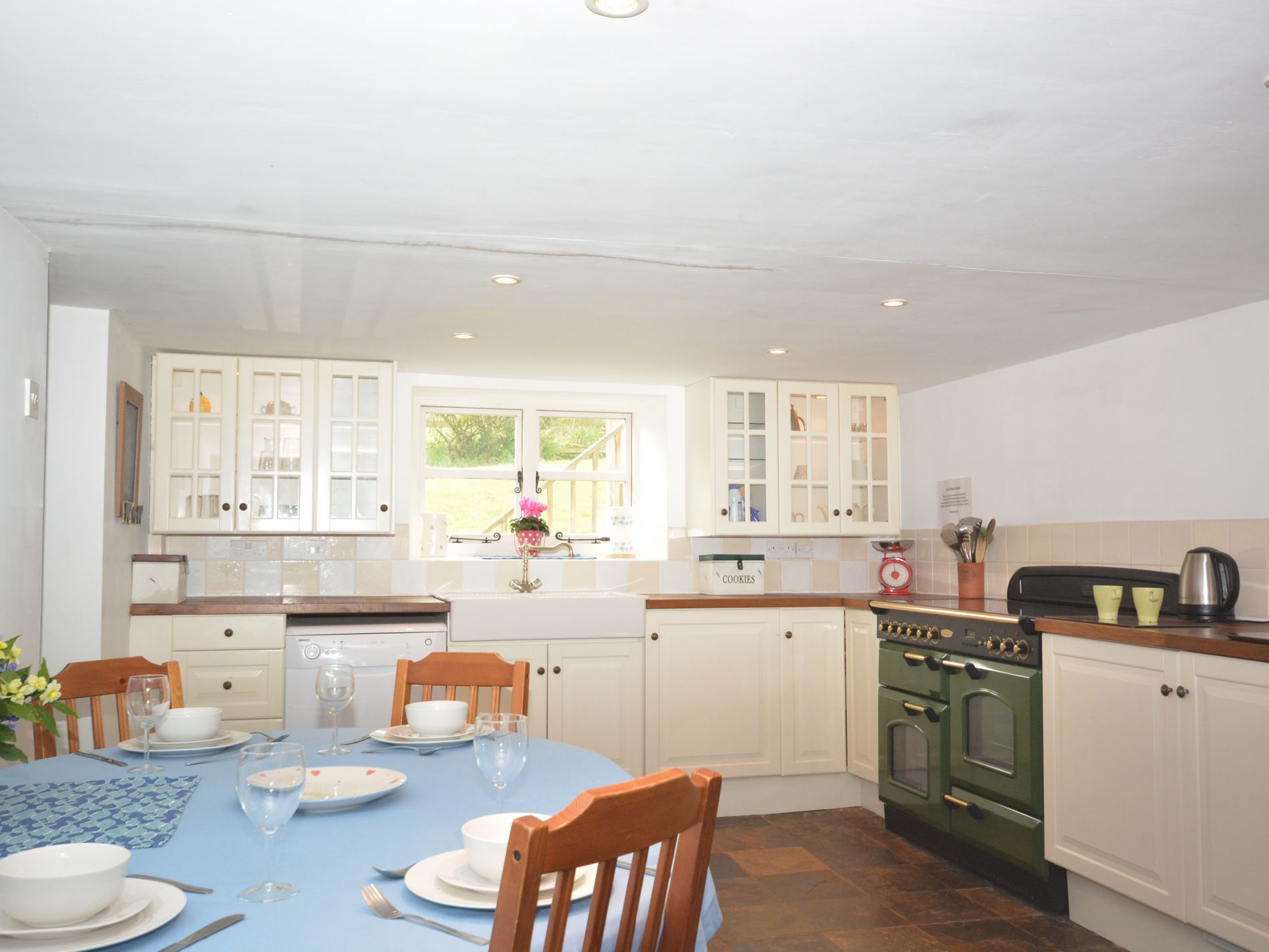 Kitchen/dining area with woodburner and sofa