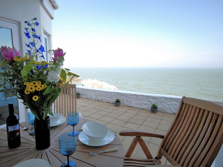 Enjoy alfresco dining and views out over the sea wall