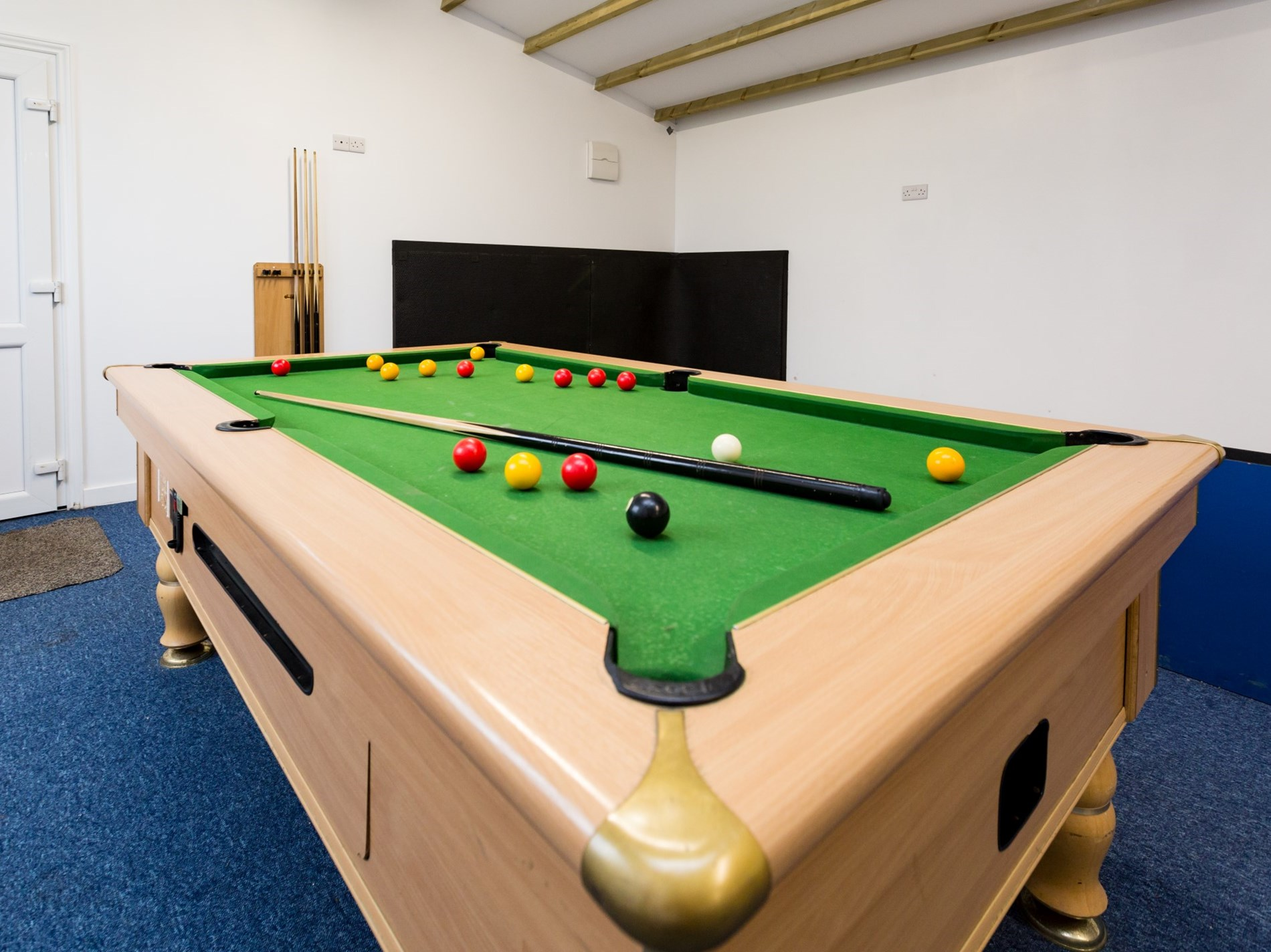 Pool table in the shared games barn
