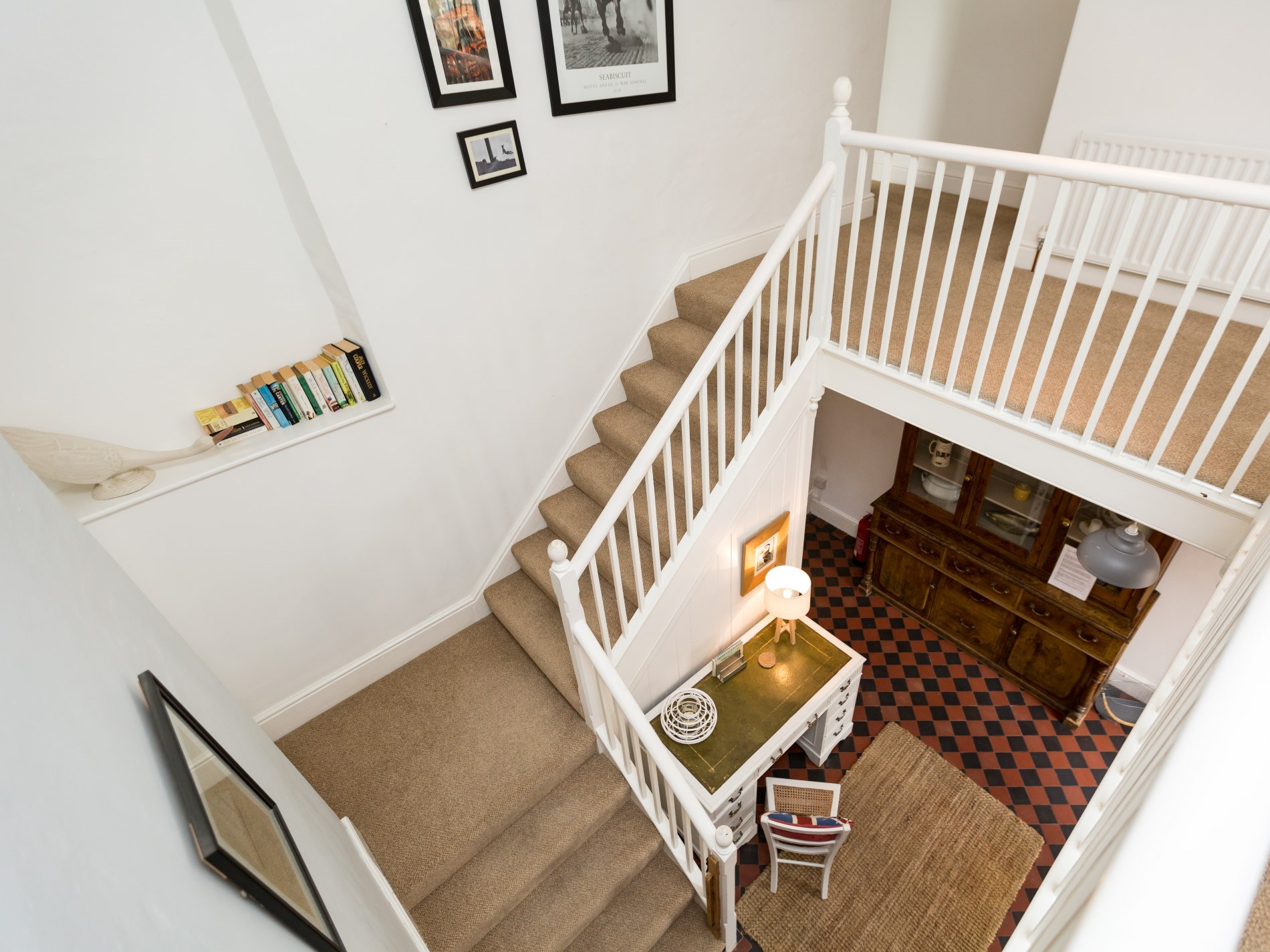 The bright and airy staircase leads you to the first floor