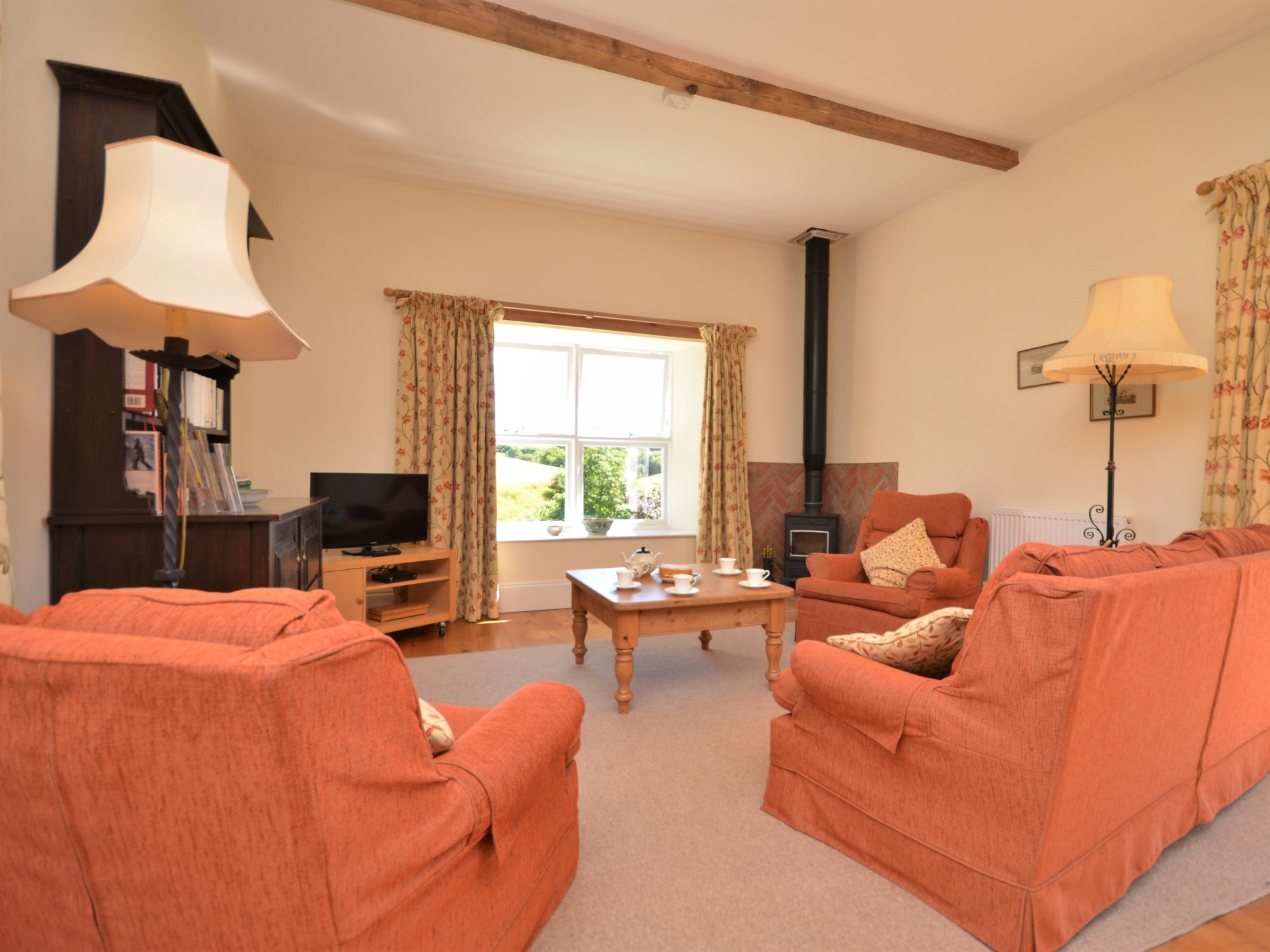 Lounge area with woodburner and country views