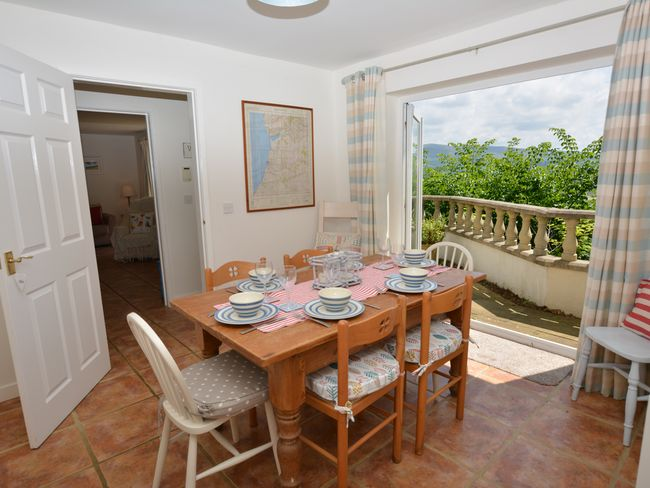 Dining area, with doors leading to the patio and beautiful views