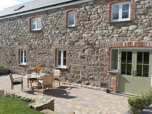 Private patio area with garden furniture