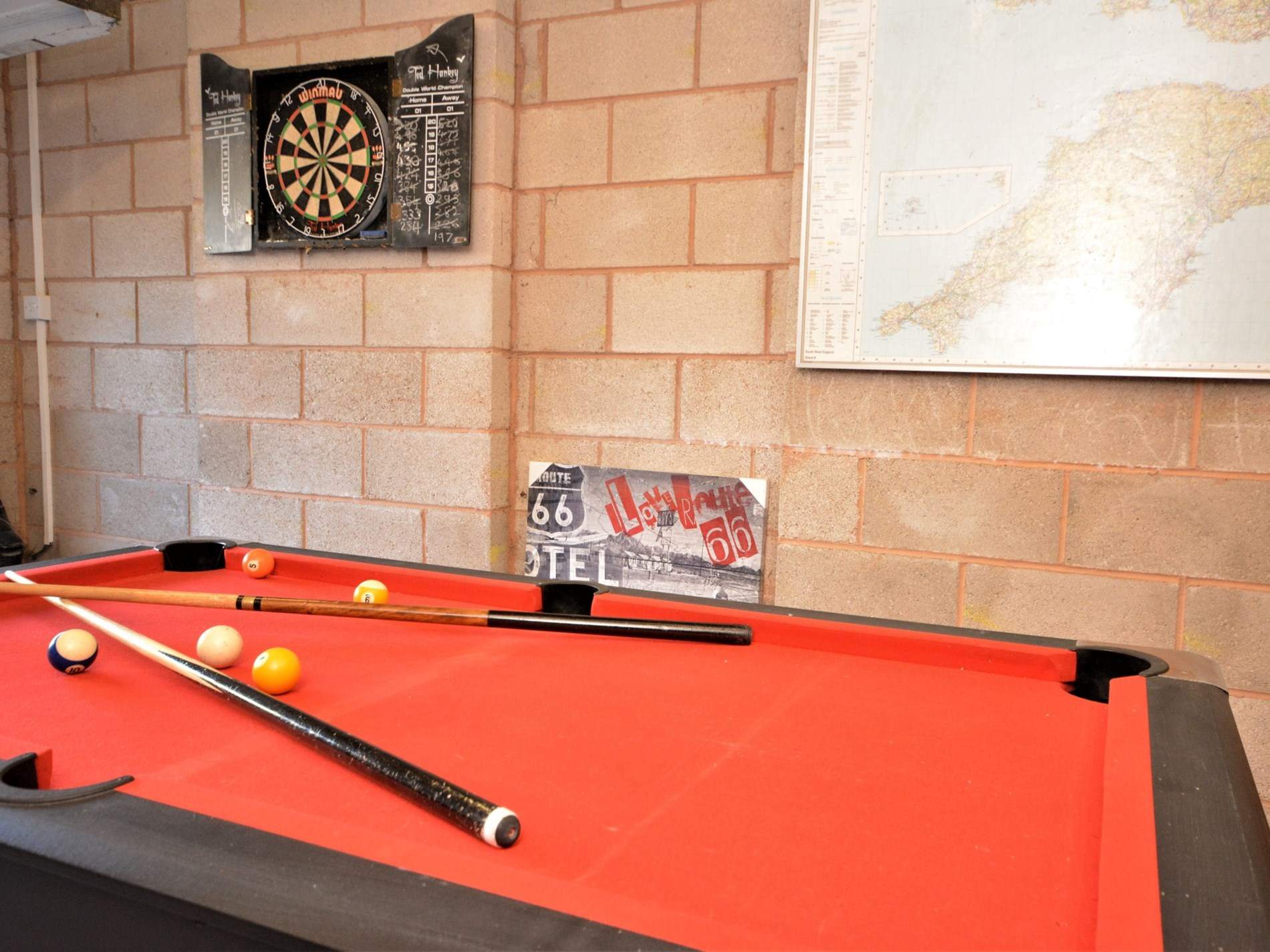 A game of pool or darts for those rainy days