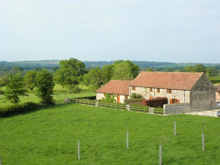 View towards the property surrounded by rolling countryside