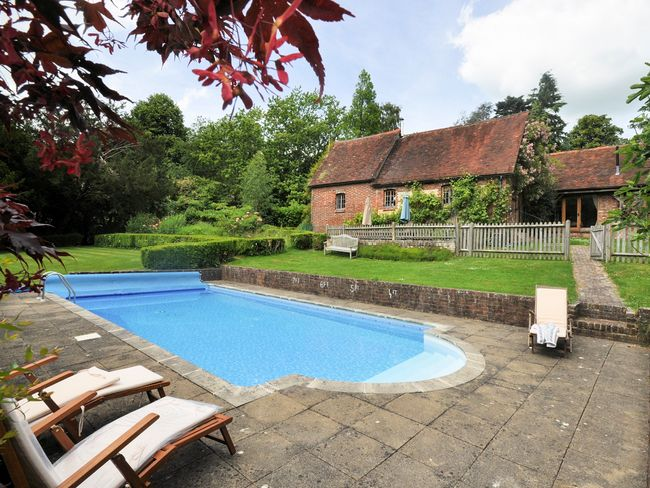 View across pool towards this converted coach house