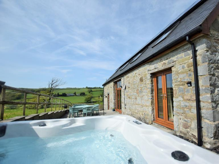 Relax and enjoy the countryside views from the private hot tub