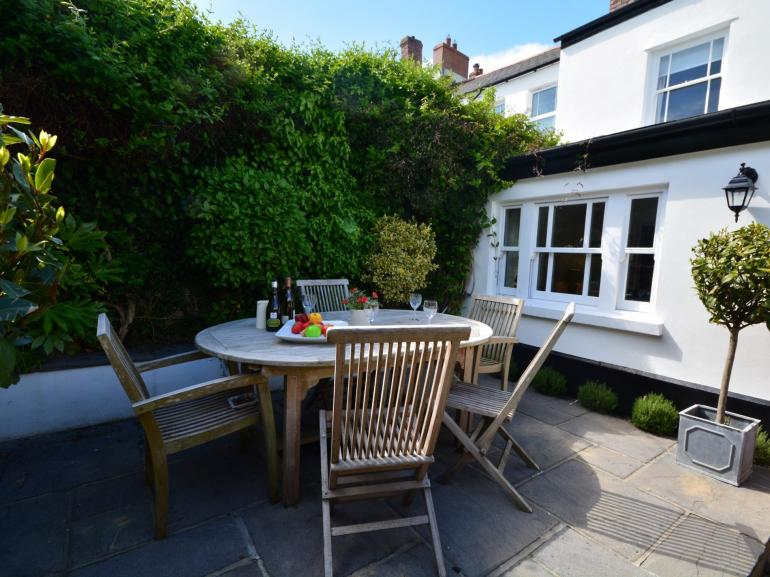 Dine al fresco in this property's courtyard