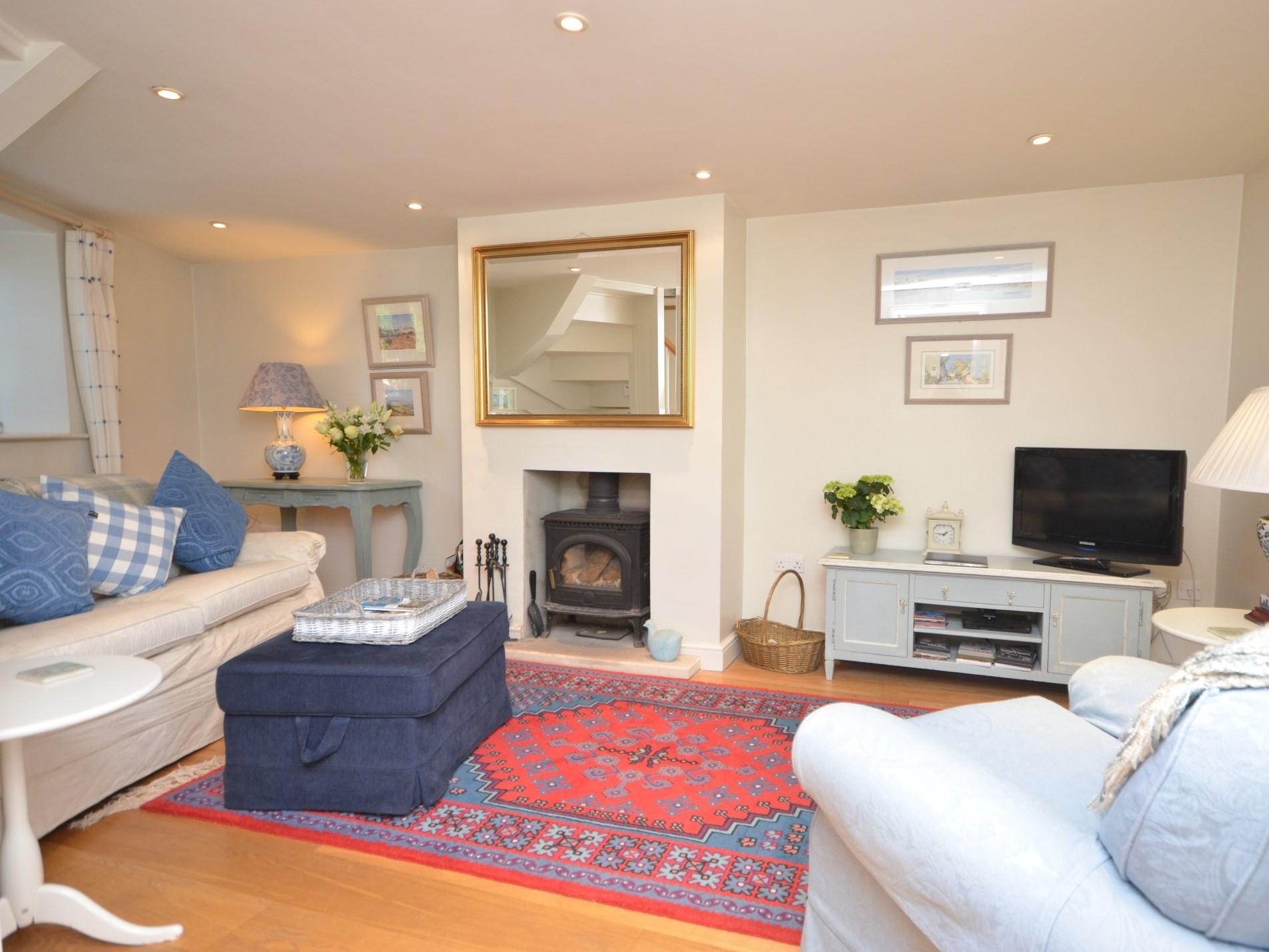 Stylishly decorated lounge with woodburner