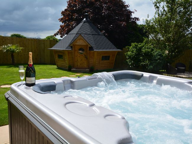 Hot tub within the enclosed garden