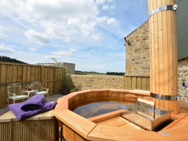 A relaxing dip in the wood burning hot tub