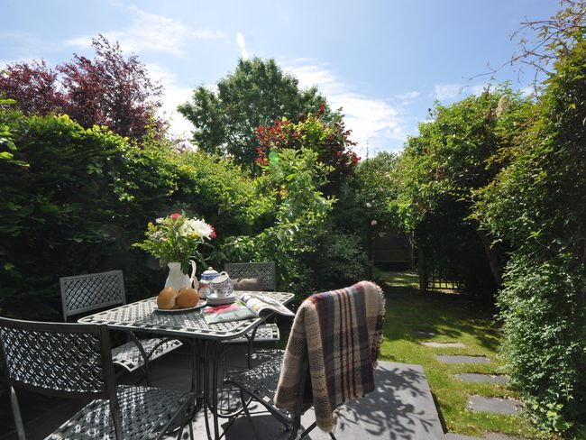 Private enclosed garden with seating area