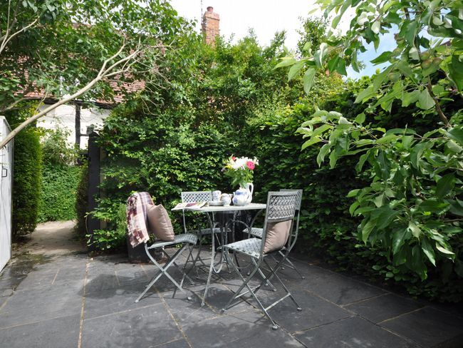 Enclosed patio with seating area