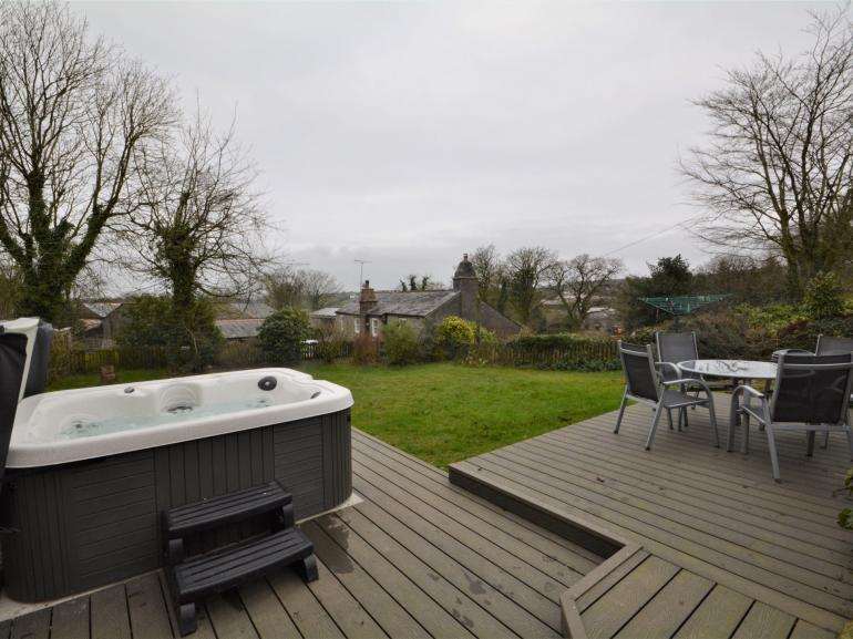 Wonderful garden area with seating and hot tub, perfect for the whole family