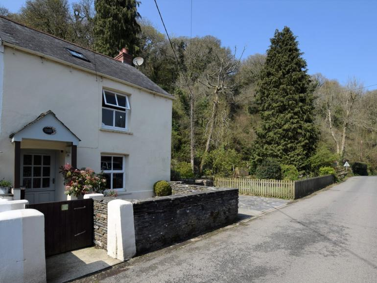 View towards the Cottage with driveway and enclosed garden