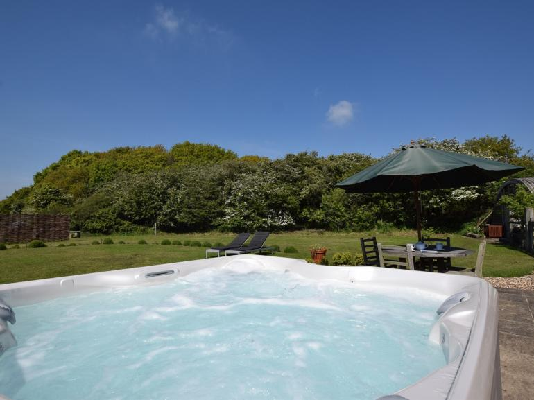 Relax in the hot tub and enjoy the peace and quiet of the countryside