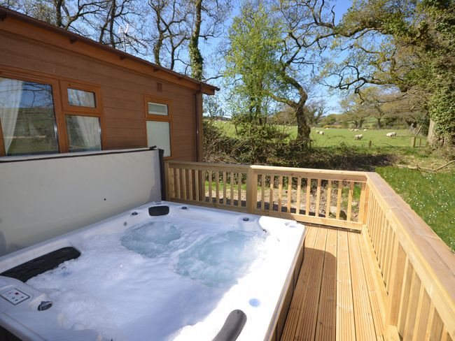 Sunken hot tub with views across surrounding fields