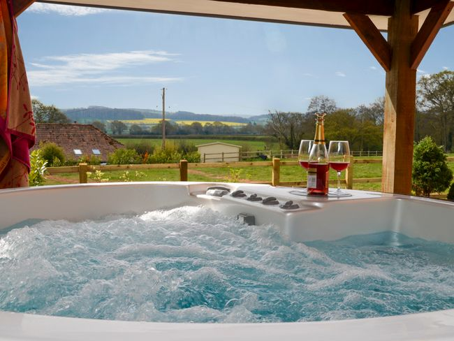 Relax in the hot tub and enjoy the beautiful views