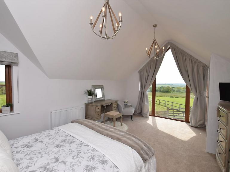 Stunning king-size bedroom with countryside views