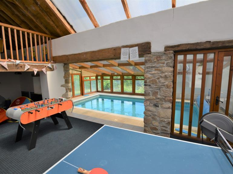Shared games barn and indoor swimming pool