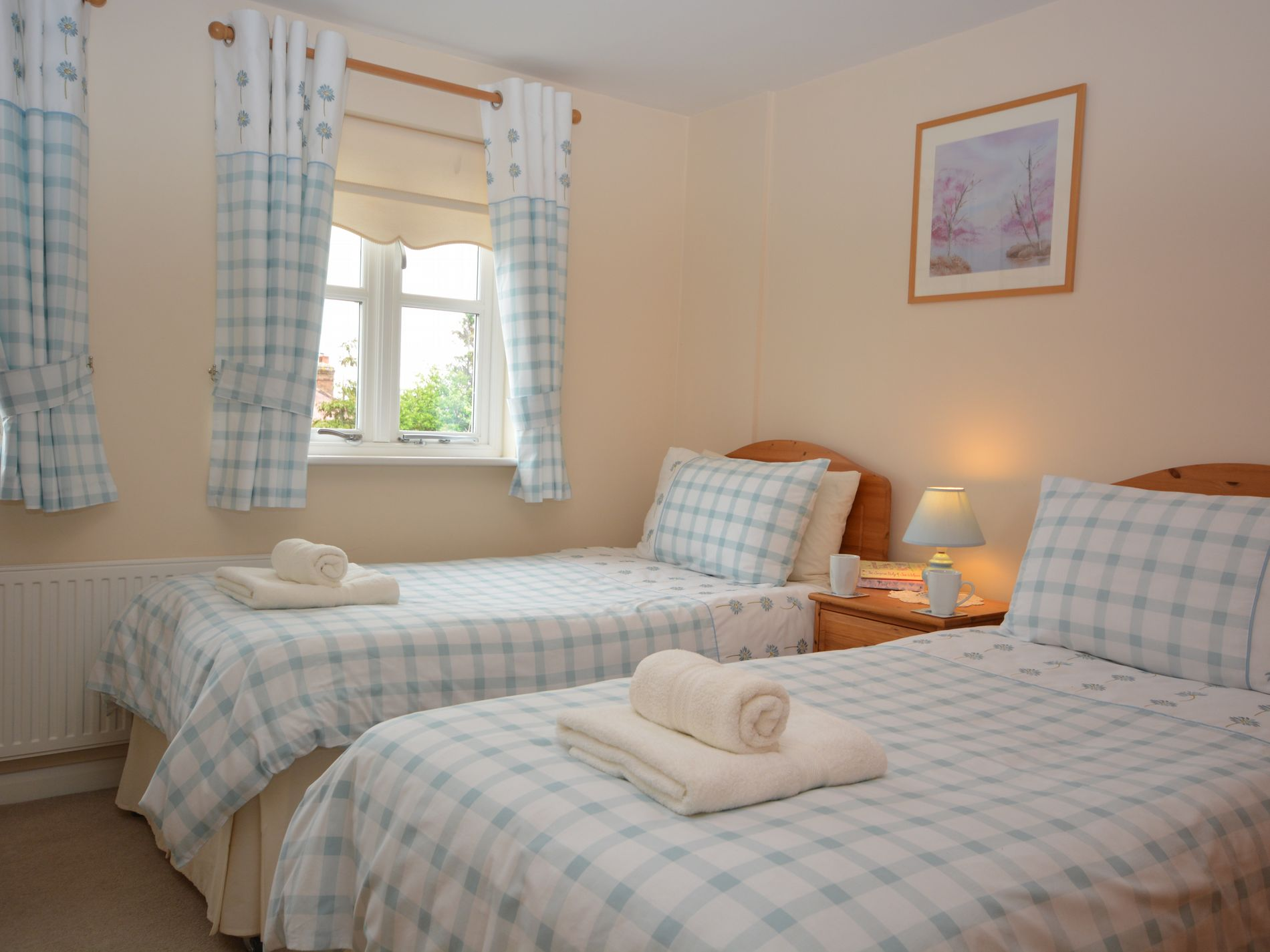 Twin bedroom with sea glimpses