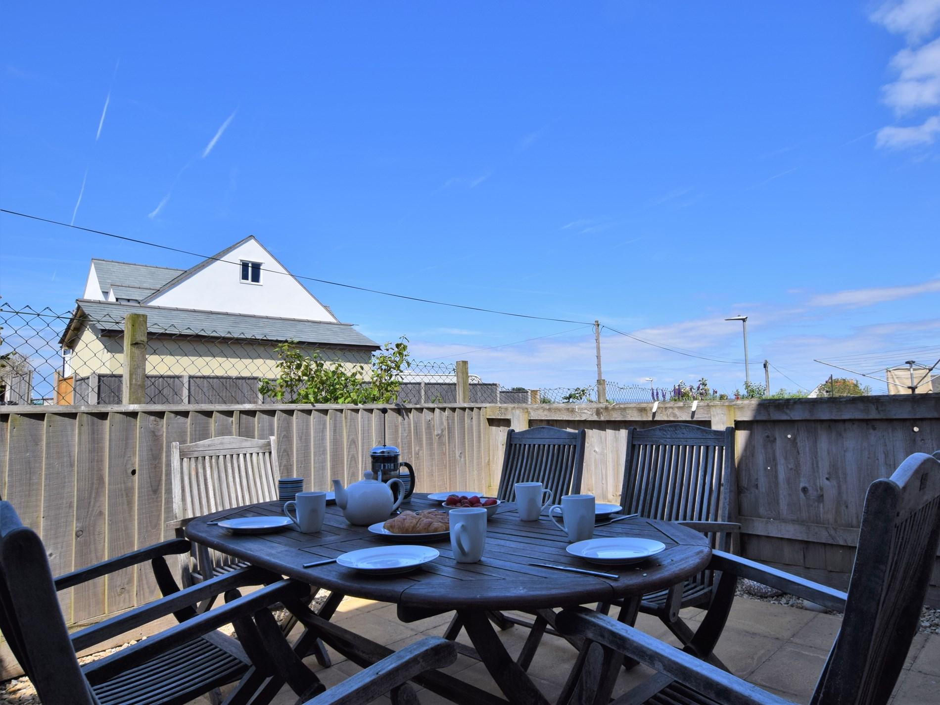 Sunny rear patio area with sea views to enjoy
