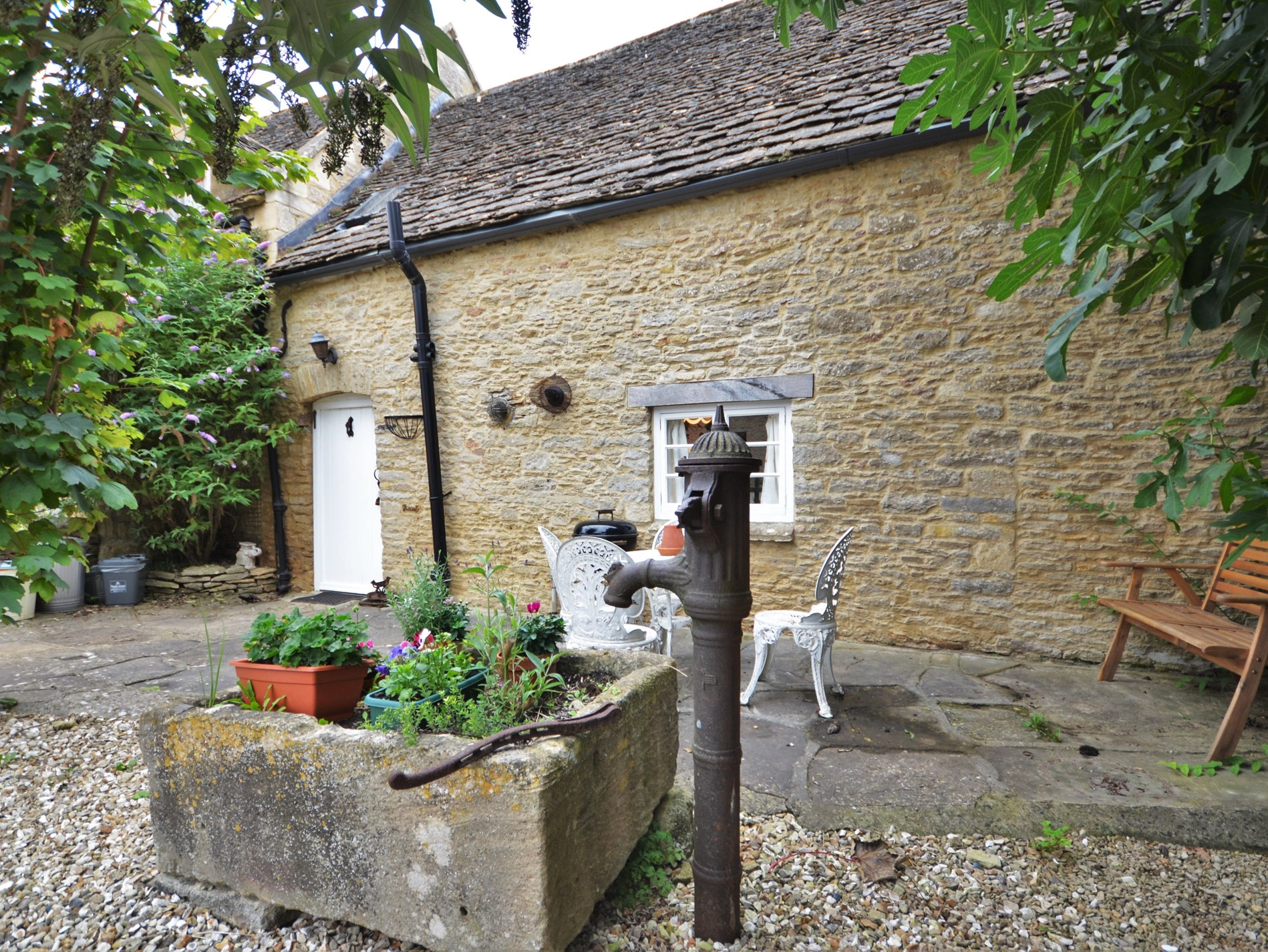 Views towards the property, outside seating area and original water pump