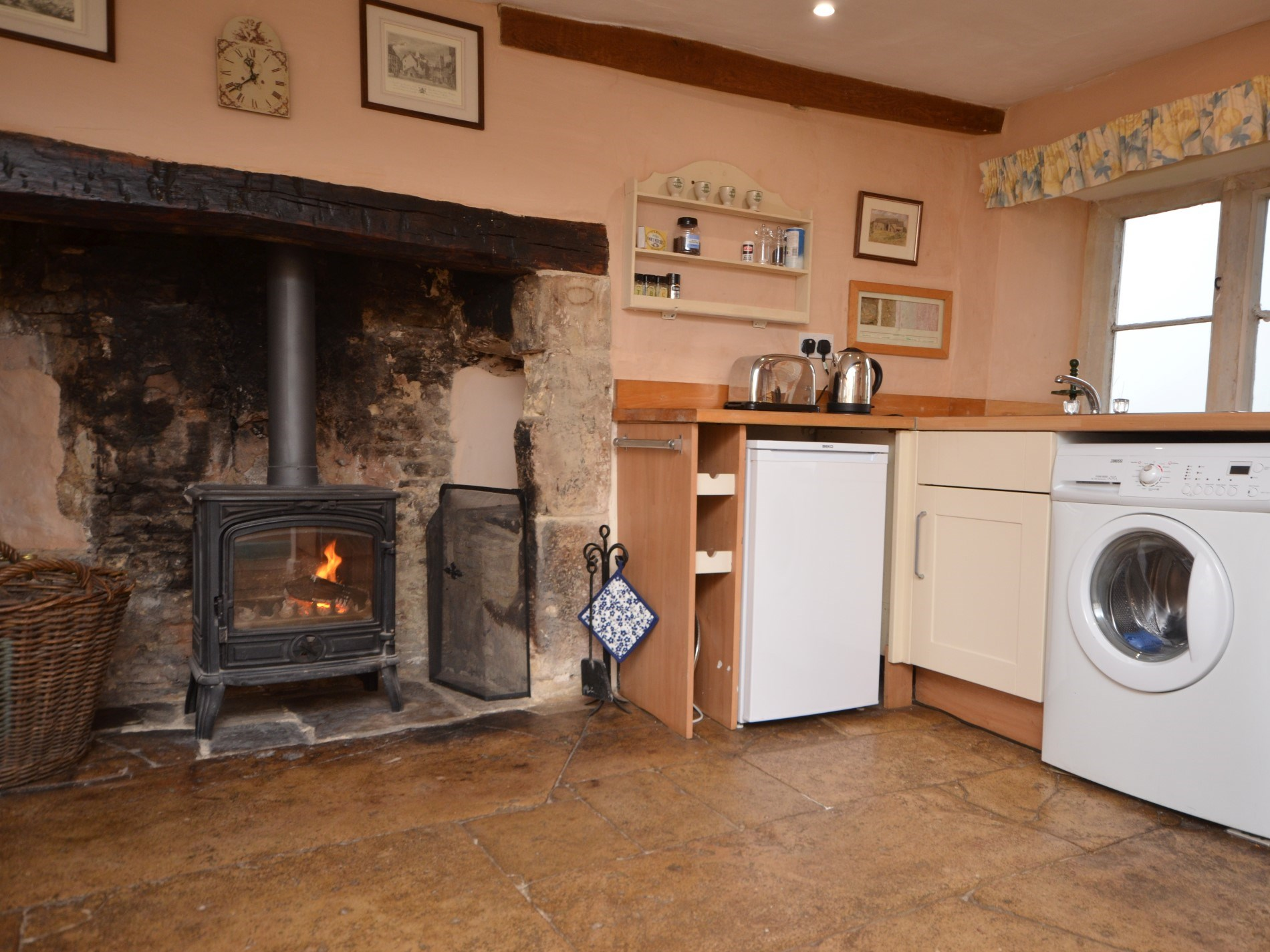 Kitchen with large woodburner