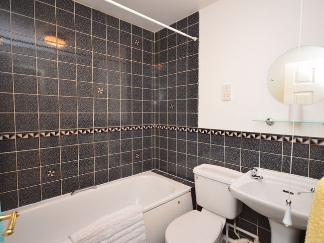 Bathroom with shower over