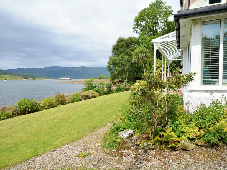 Lawned garden with views across to Bute