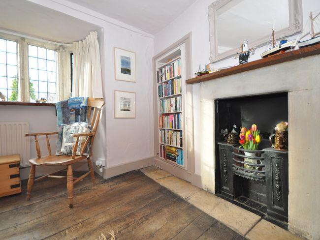 Feature fireplace in double bedroom with en-suite shower room