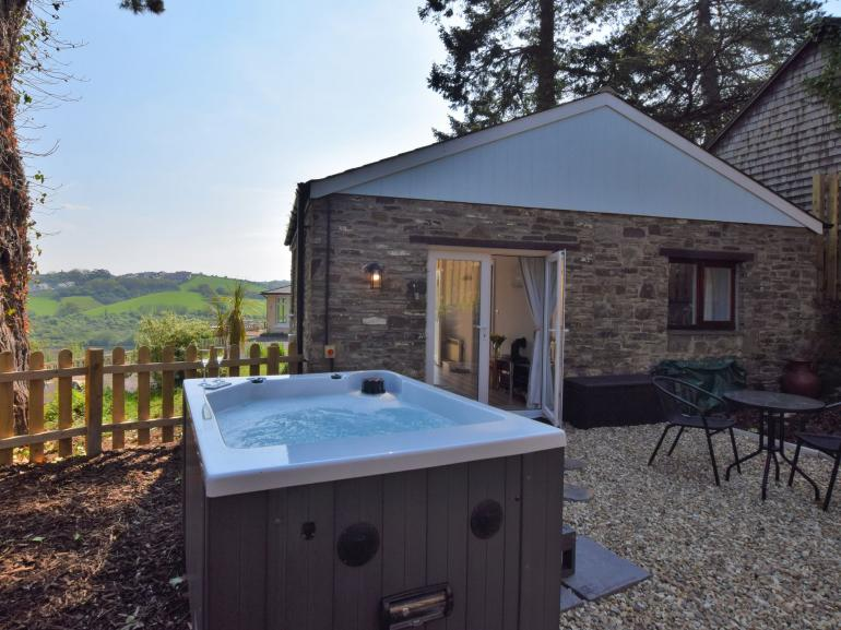 Rear view of the property with stunning views and hot tub