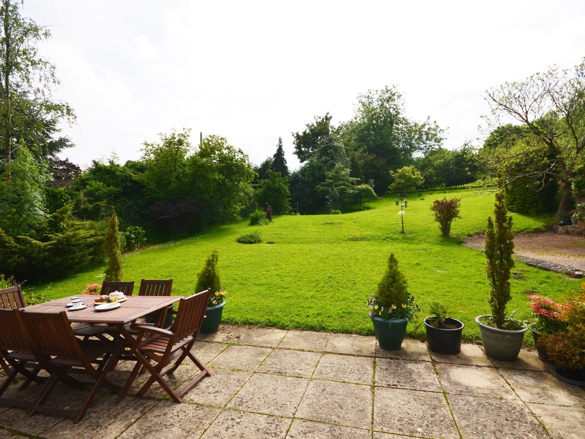 Patio and seating area with views over the garden and orchard