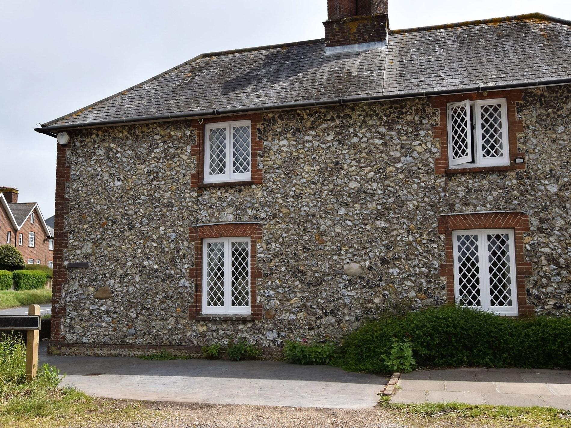 A pretty mid-19th century flint cottage