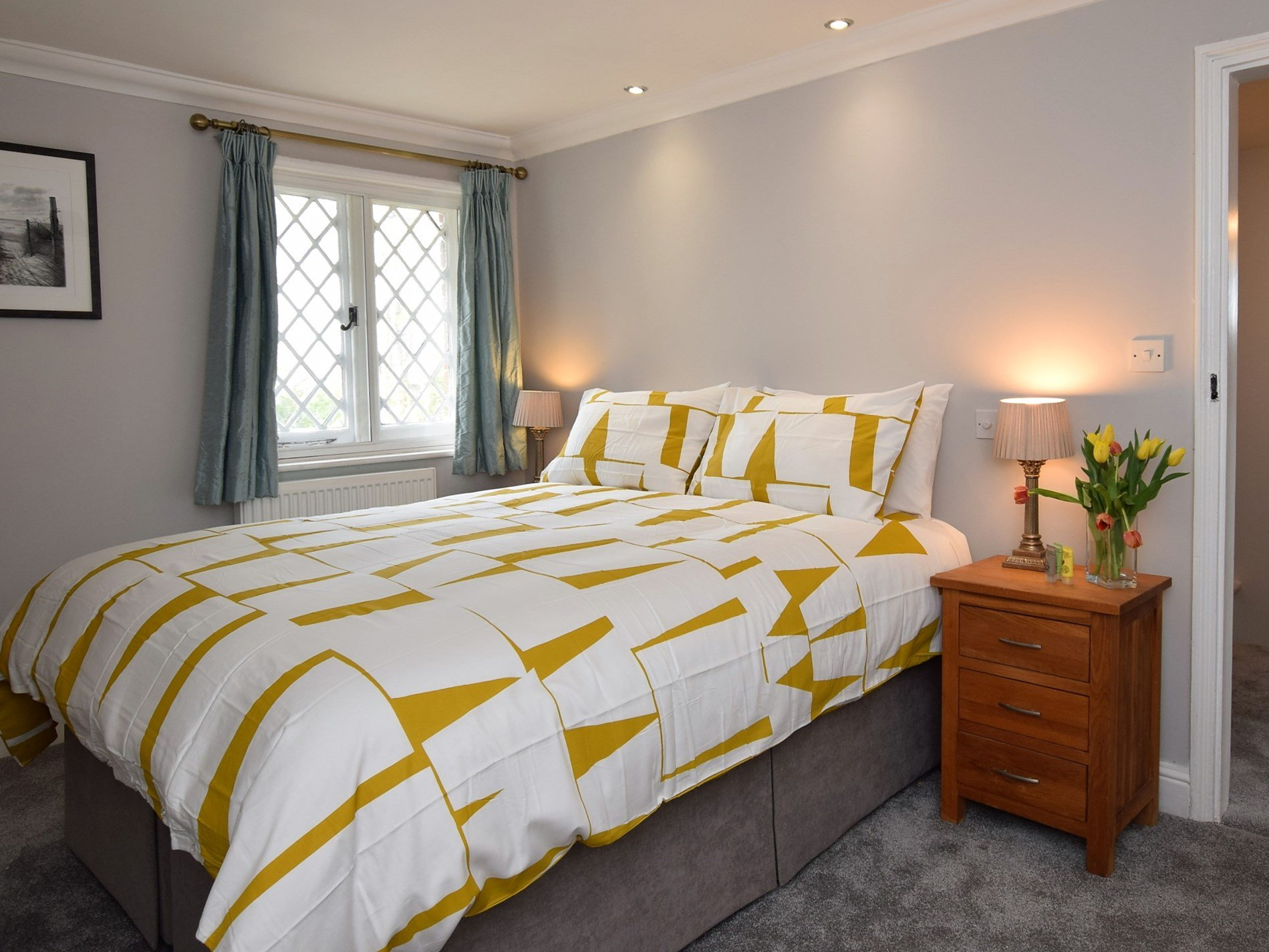 A bright and airy king-size bedroom