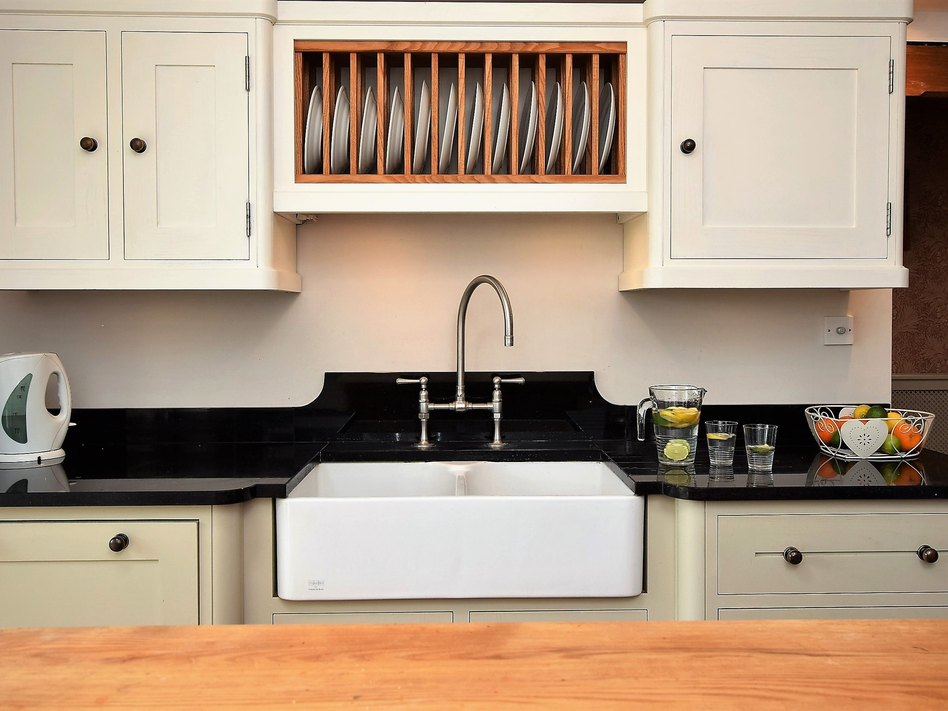 A traditional butler sink offers the cottage charm