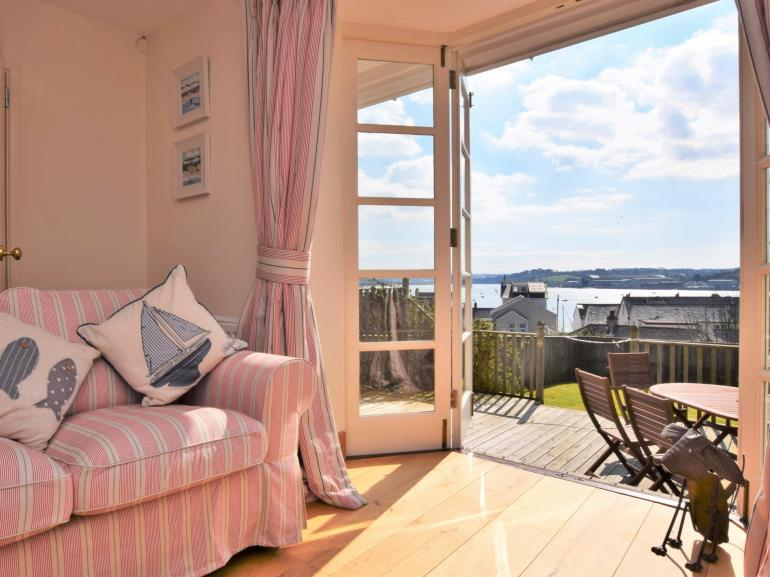 Stunning views across the estuary from the lounge leading to decking and garden