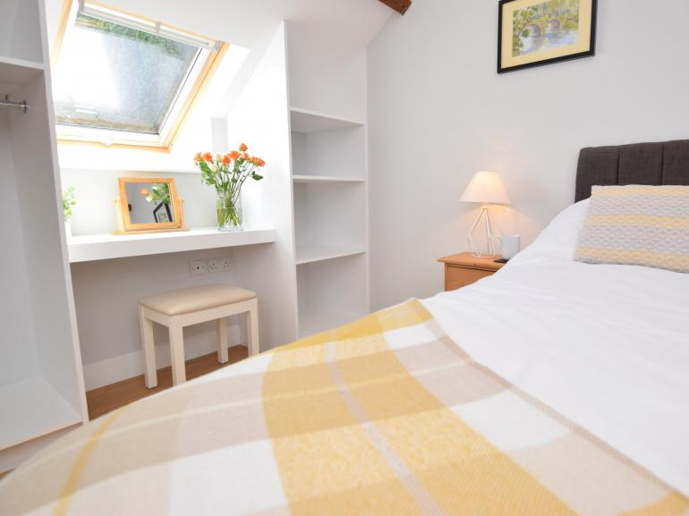 King-size bedroom with built in wardrobe storage and dressing table