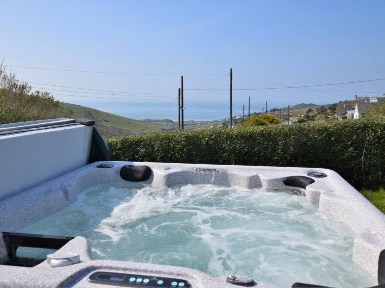 Hot tub with views towards the sea