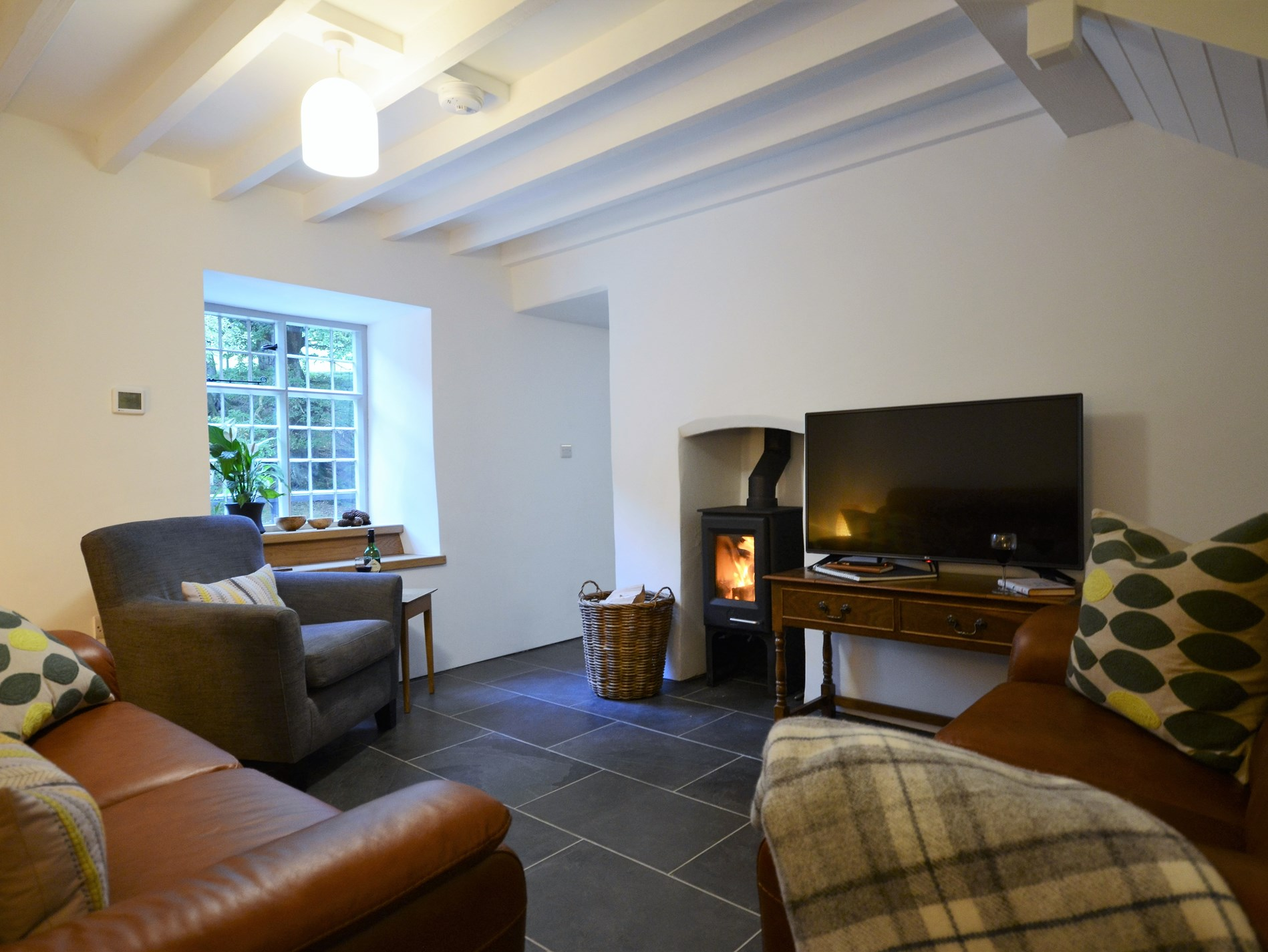 Cosy lounge, perfect for curling up in front of the woodburner
