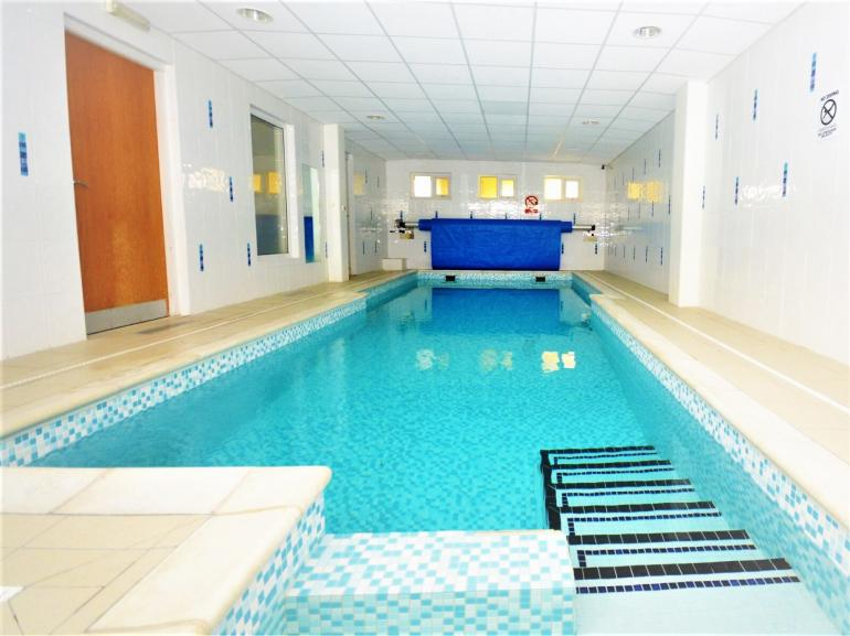 Shared indoor pool, steam room and sauna